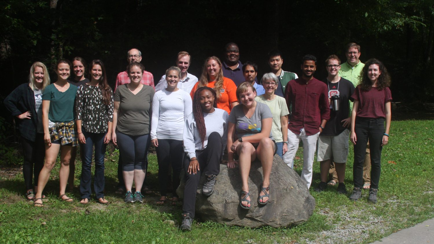Group of graduate students and staff at camp