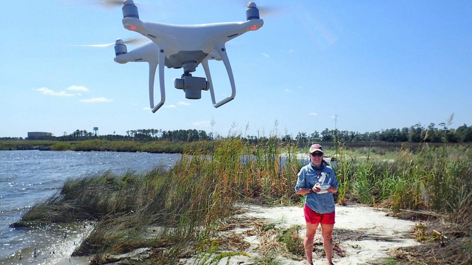 Erin Voigt flying the drone that she uses in her research