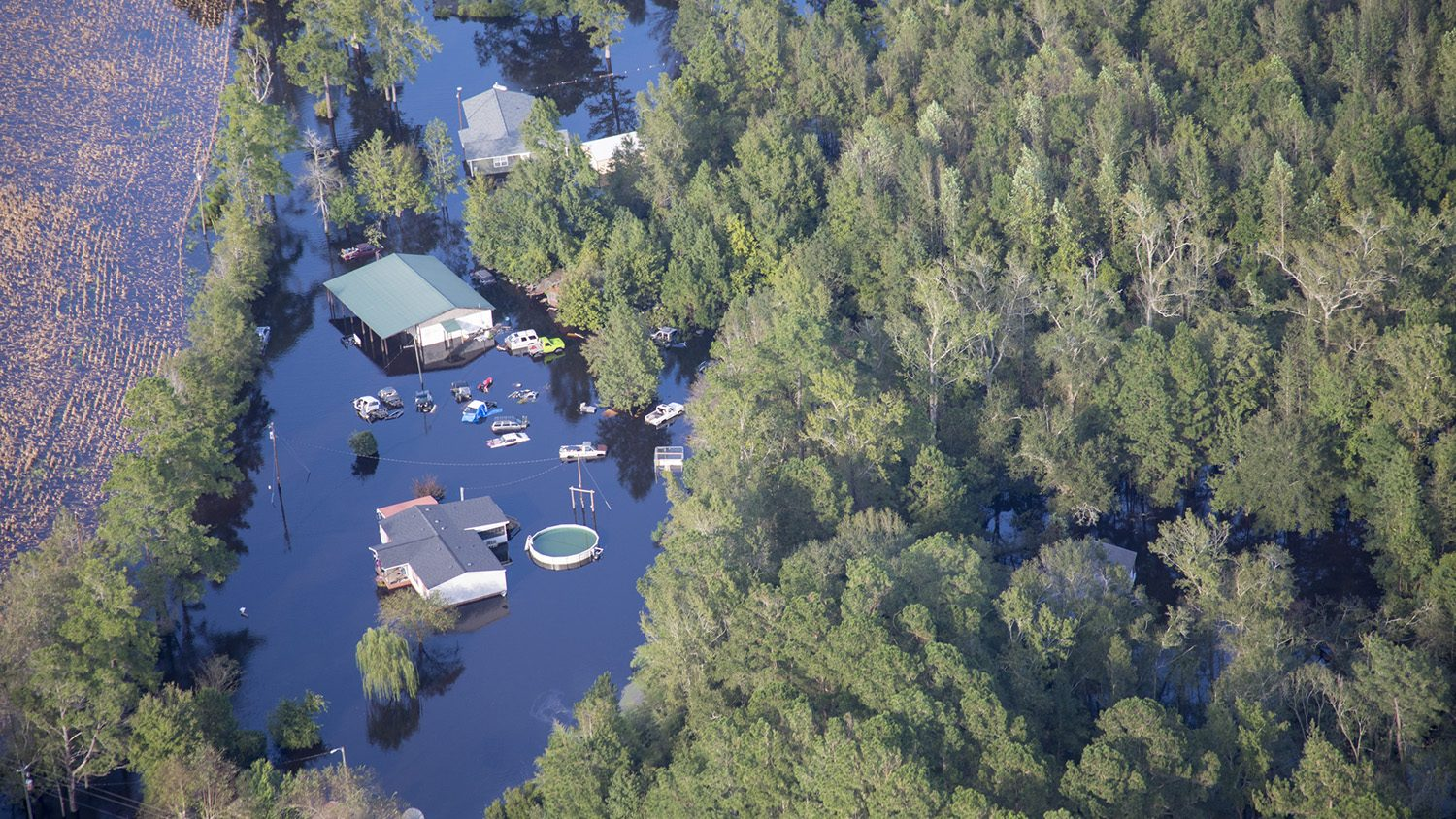 Hurricane Florence causes the Cape Fear River to flood, nearly submerging homes, above ground swimming pools, and vehicles.